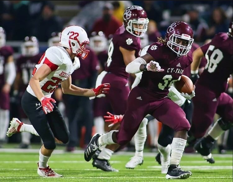 Walter+Truitt+tackles+a+Cy-Fair+player+during+a+2019+playoff+game.+Photos+provided+by+Walter+Truitt