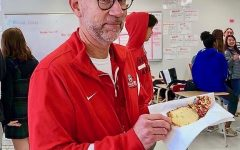 Mr. McDonough enjoys a piece of cake at last years Dessert Club meeting.
