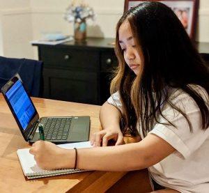 Freshman Cassandra Darmodjo writes reminders on her agenda.