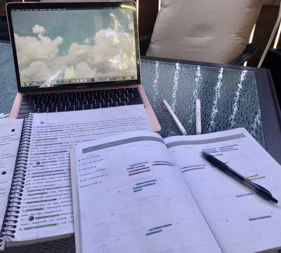 Junior Contessa Ferreras writes notes into a planner essential to keeping her motivated and focused while remotely learning.