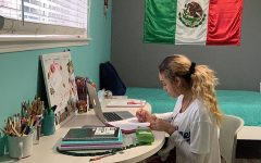 Maria Perez completes her virtual homework at her desk.