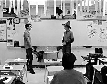 Senior Dawson Benner and college freshman Carson Benner practicer their skit in German class.
