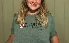 Sami Ferguson shows off the shirt she received from Rhodes College.