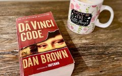 Taryn Morris reads The Da Vinci Code while drinking a cup of hot chocolate. Published in 2003 and having around 80 million sold copies, The Da Vinci Code is one of the best-selling books of all time.
