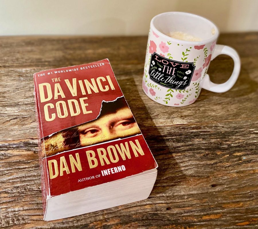Taryn+Morris+reads+The+Da+Vinci+Code+while+drinking+a+cup+of+hot+chocolate.+Published+in+2003+and+having+around+80+million+sold+copies%2C+The+Da+Vinci+Code+is+one+of+the+best-selling+books+of+all+time.