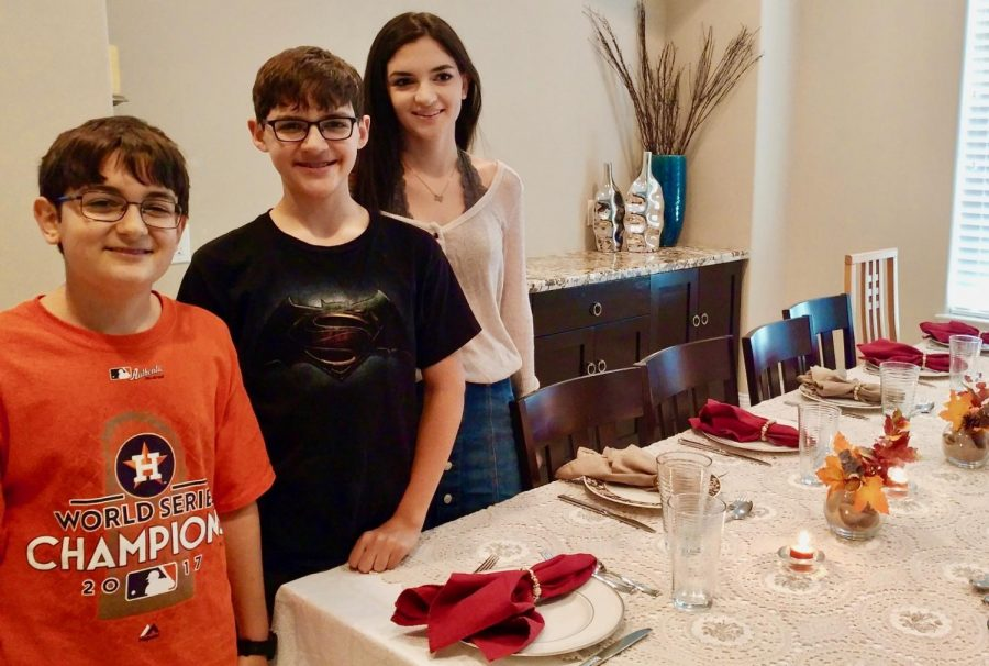 Matan Lagnado stands beside the Thanksgiving meal with his brother and sister in 2017 before sitting down to enjoy the meal with the rest of his family.