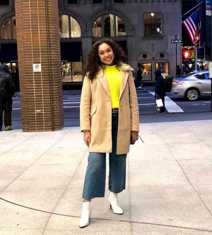 Junior Isabella Batarse wears a beige trench coat from Zara, a Banana Republic sweater, H&M jean flare pants, and white Banana Republic ankle boots.