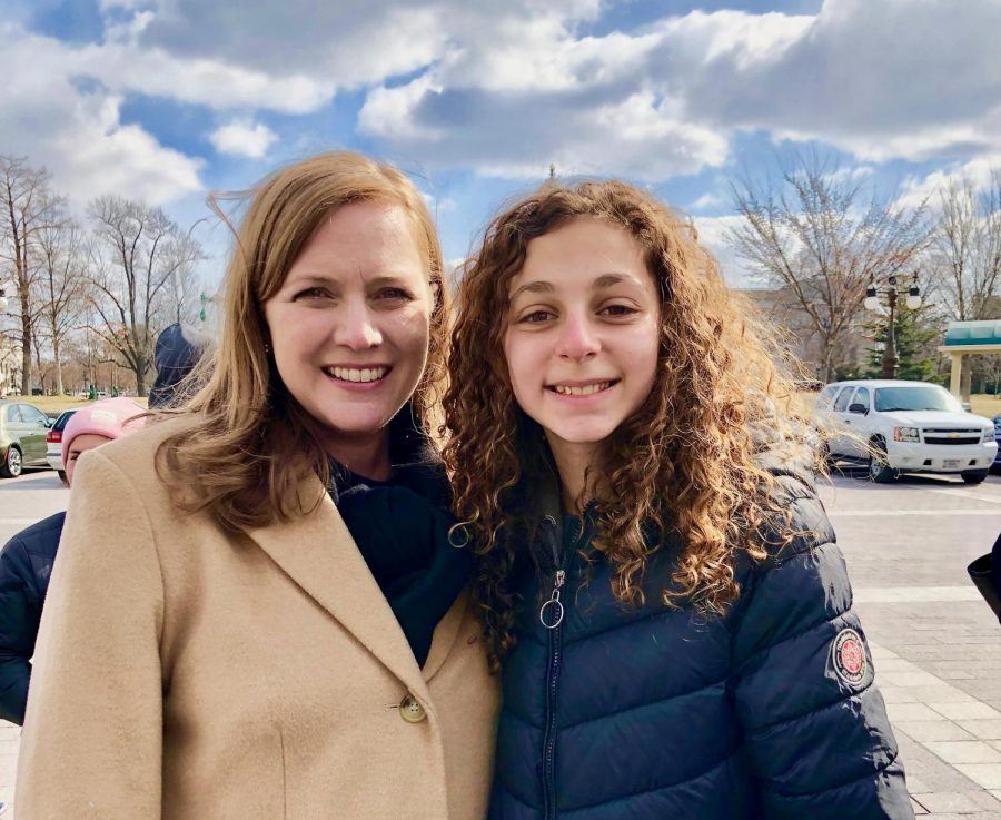 In 8th grade, current sophomore Sara Wolf, takes a picture with Congresswoman Lizzie Fletcher.