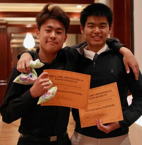 Andrew Sun (left) and William Fan (right) pose with their duet certificates at the Bellaire Piano Banquet.