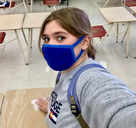 Wiping down the desks has become a part of junior Amber Alvarez's school routine. It is one of the protocols students follow while attending in-person school.