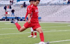 Ricky Kai shoots the soccer in preparation for the game against Lamar at Delmar Stadium during his sophomore season.