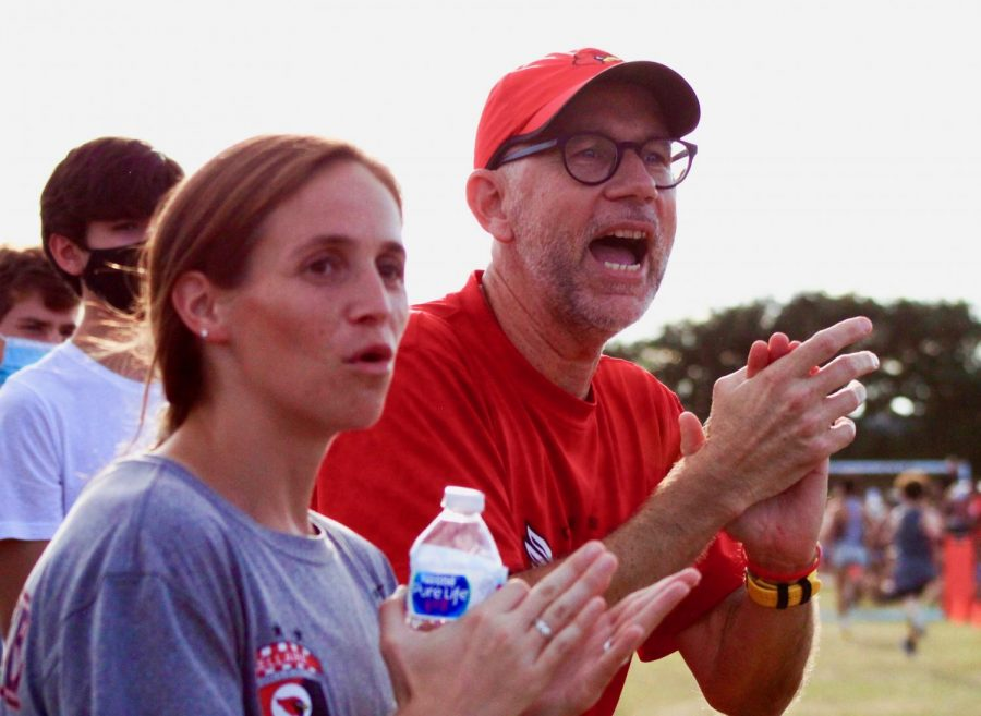 Principal+Michael+McDonough+and+Ms.+Kelli+Tomlinson+cheer+on+the+runners.+