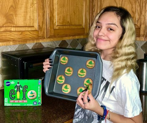 Senior Maria Perez shows off her favorite holiday treat, a tray of Pillsbury cookies.