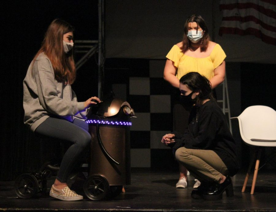 Actors Jolie Laporte, Leah Harvell, and Rosalinda Cano, rehearse their scenes together. In After the Blast, Anna, played by Harvell, desperately wants to have a child but can't because of new regulations and she grows attached to this robot.