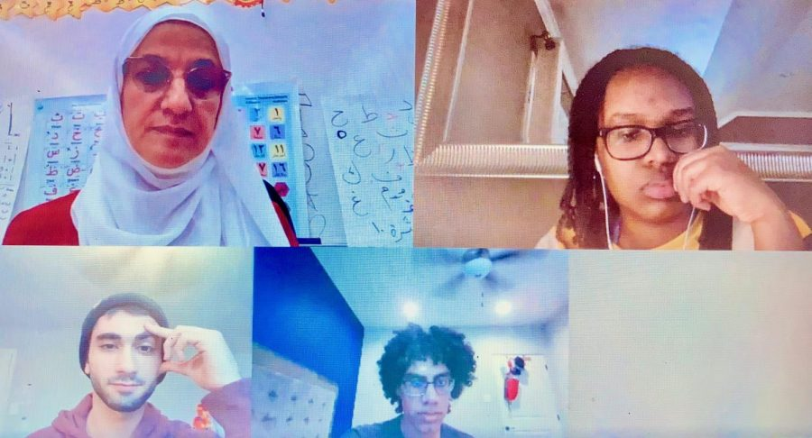 """The MSA Club researches information for upcoming """"Muslims in China"""" event. From left, Arabic teacher Salma Halabi, Abdallah Aljerjawi, Omar Busaidy and Iman Suleman."""