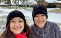Junior Adeline Camero poses outside her house with her mother. She enjoys her first snowfall since 2009.