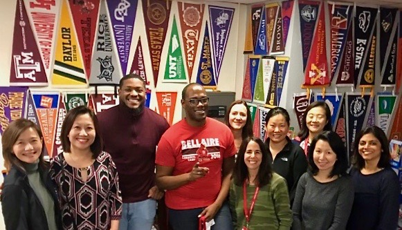 Parents gather around College Advisors Davonta Lee and Marcus Stewart in the College Career Center after a meeting during the 2019-20 school year.