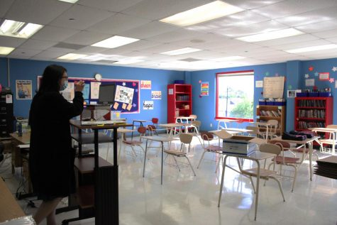 English teacher Jennifer Blessington teaches to an empty classroom. Normally classes in Bellaire could have up to 30 students per room. Now they have about 1 to 5.