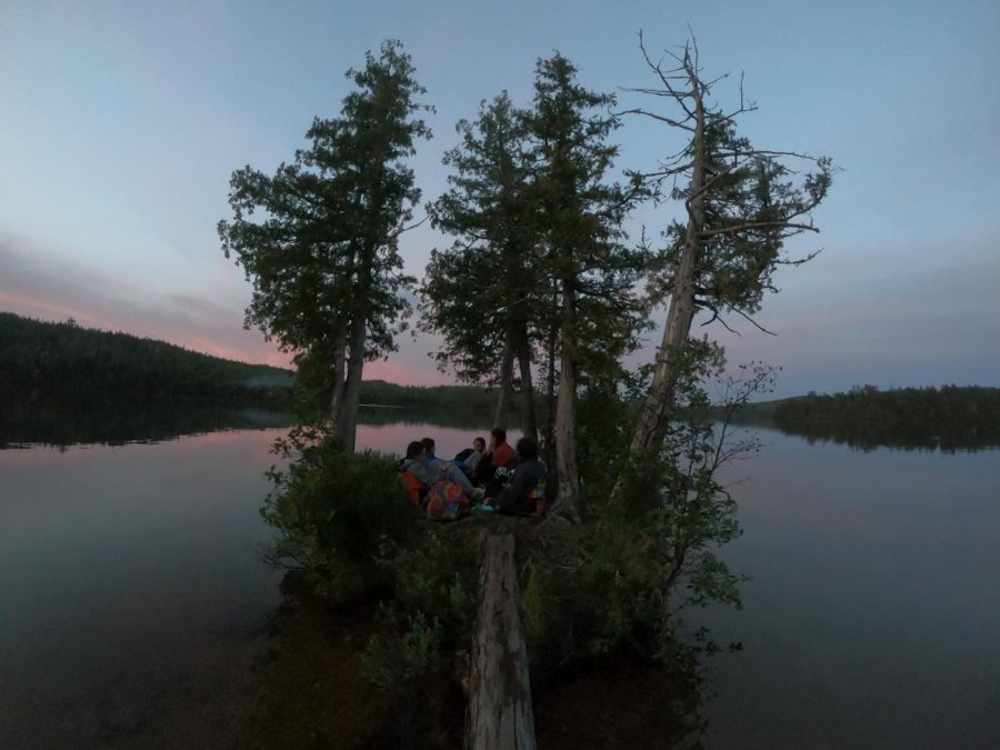 Sophomore Sara Wolf and her trip-mates congregate on a small island attached to the evening