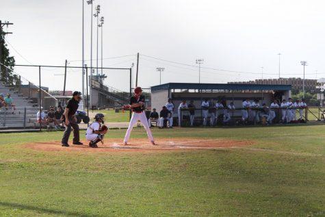 Senior Ben Finley heads up to bat against Lamar High School.