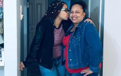 Senior Ligoriana Dillon (left) kisses her mom's cheek in their apartment. Dillon and her mom were just returning home from sightseeing in Downtown Houston.