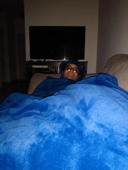 Sophomore Aniket Panicker sleeps on the couch as the mini-artic freeze reaches its peak. He is covered in three layers of blankets and is shivering as the room temperature hits a low of 52 degrees Fahrenheit.