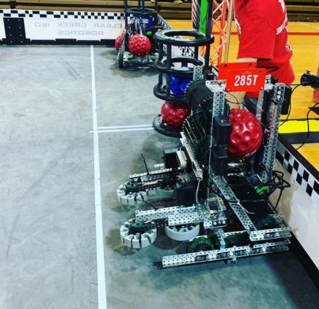 Robotics club president Jimmy Xi prepares the robot for the VEX AI competition. The team plays under the team 285T, and the goal is to make the robot complete various tasks autonomously.