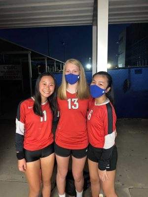 Chen (left) plays with Camille Lasics and Kylie Nguyen in her last game of the season with the freshmen volleyball team, which consists of seven members, the smallest team she has ever been a part of. The group went undefeated in district and clinched the district title.