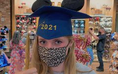 Senior Abby McMorris at a souvenir shop in Disney Springs. She found Mickey ears as a graduation hat and found it fitting to pose for a picture. (Photo credit to Abby