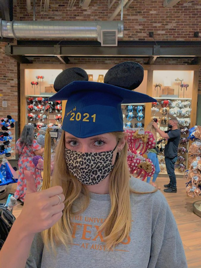 Senior+Abby+McMorris+at+a+souvenir+shop+in+Disney+Springs.+She+found+Mickey+ears+as+a+graduation+hat+and+found+it+fitting+to+pose+for+a+picture.+%28Photo+credit+to+Abby+