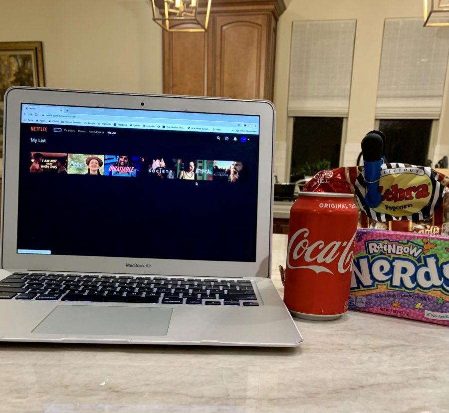 Sophomore Sophie Hinh prepares her perfect Netflix-watching set up. She has her favorite candy and snacks within reaching distance.