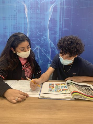 Junior Ivanna Gonzalez and freshman Ian Alecio study for an upcoming Italian test. Alecio considers his cousin Gonzalez as a role model.
