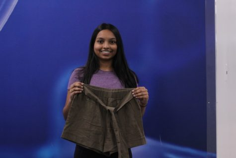 Smruthi Garlapati shows off a pair of shorts she purchased from Shein for just $6. She expected the shorts to be made of a soft material but received thin, scratchy shorts that wrinkle after one use.