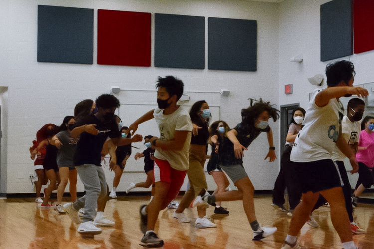 The eMotion Hip-Hop dance section practice for the upcoming fall show this Nov. 19 in room 2205. Junior EJ Brotamonte choreographed this routine.