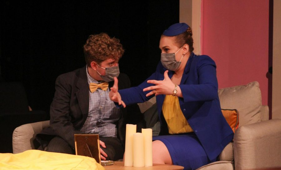 Freshman Thomas Haeden and senior Jenny Katzen perform a bit during the earlier half of the play. Haeden played Bernards college friend, Robert, while Katzen played Bernards German fiancee, Gretchen.