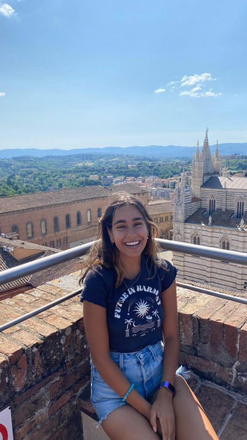Angelina Pascali rests at the top of the Torre del Mangia after climbing the 400+ steps leading up. Pascali studied abroad in Italy this summer.