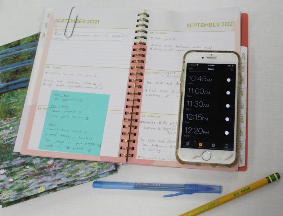 Trinity shares a few of the tools she uses to keep herself organized. This includes two planners, sticky notes and phone alarms.